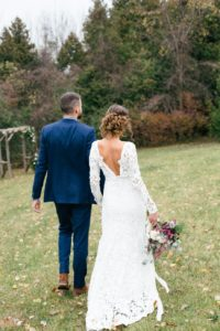 bride-and-groom-walking-on-the-grass