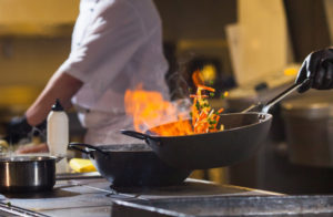 cook-making-dinner-kitchen-high-end-restaurant_110955-325