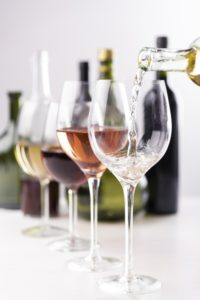 wine-pouring-into-glasses-close-up_23-2148261649